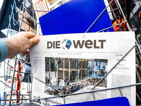 Paris, France - Jul 24, 2019: Annegret Kramp-Karrenbauer speech in Bundestag - man buying at press kiosk latest Die Welt newspaper Redakční