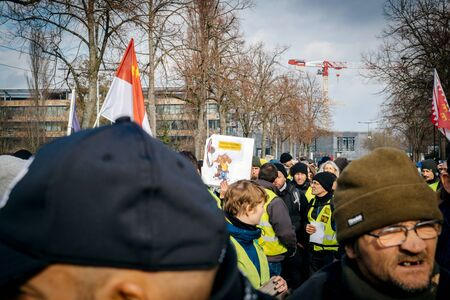 STRASBOURG, FRANCE - FEB 02, 2018: People marching during protest of Gilets Jaunes Yellow Vest manifestation anti-government demonstrations do not touch my chocapic