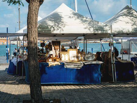 Barcelona, Spain - Jun 1, 2018: Flea market waiting for customers sea view near the Mirador de Colom near Rambla de Mar Redakční