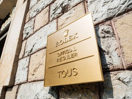 Barcelona, Spain - Jun 1, 2018: Rolex official retailer Tous in central barcelona special golden plaque on the stone wall on the famous shopping street