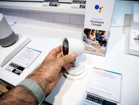 Paris, France - Jul 25, 2019: Man hand testing the Nest Cam IQ new premium model of Nest Cam Indoor featuring a 4K camera sensor with HDR