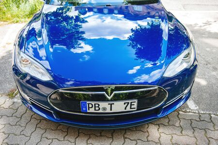 Strasbourg, France - May 19, 2016: View from above over the front trunk of new modern luxury Tesla Model S 90D electric supercar in beautiful blue color parked on the French street