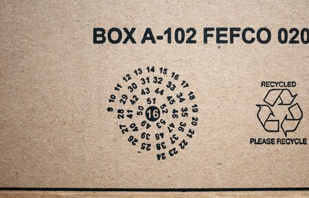 Paris, France - Jan 29, 2019: View from above at the Amazon e-commerce parcel cardboard box with date of the manufacture and Recycled Please recycle sign