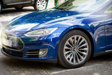 Strasbourg, France - May 19, 2016: Front part of new modern luxury Tesla Model S 90D electric supercar in beautiful blue color parked on the French street Redakční
