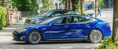 Strasbourg, France - May 19, 2016: Side view of new Modern luxury Tesla Model S 90D electric supercar in beautiful blue color parked on the French street