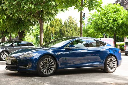 Strasbourg, France - May 19, 2016: Low angle view of modern luxury Tesla Model S 90D electric supercar in beautiful blue color parked on the French street Redakční