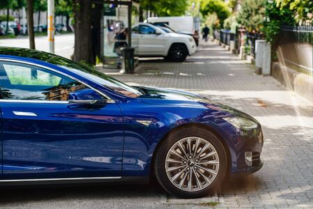 Strasbourg, France - May 19, 2016: Side view of front part modern luxury Tesla Model S 90D electric supercar in beautiful blue color parked on the French street