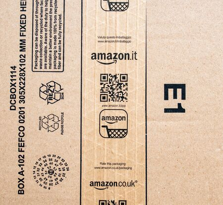 Paris, France - Jan 29, 2019: View from above at the Amazon Prime cardboard box with Amazon.it Italia co.uk United Kingdom sticker scotch - instruction of the packaging recycling