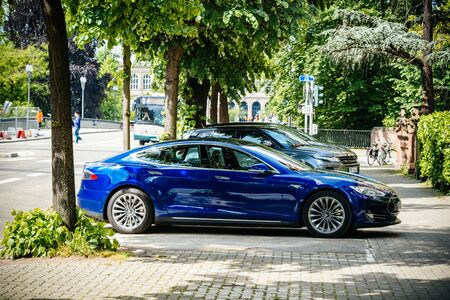 Strasbourg, France - May 19, 2016: Modern new Tesla Model S 90D electric supercar in beautiful blue color parked on the French street Redakční