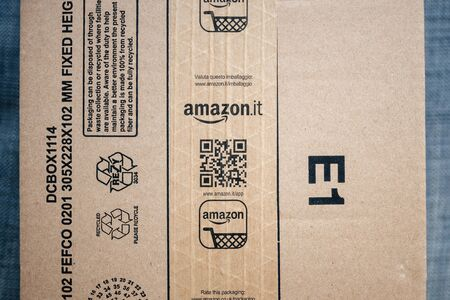 Paris, France - Jan 29, 2019: View from above at the Amazon Prime cardboard box with Amazon.it Italia sticker scotch - instruction of the packaging recycling