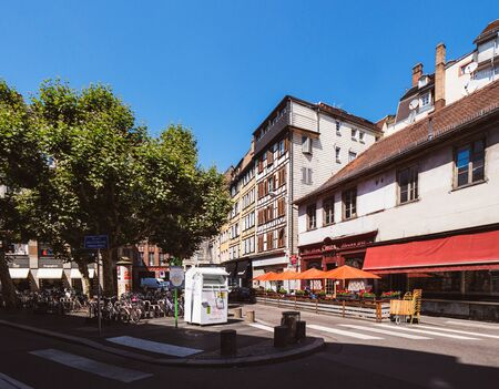 Strasbourg, France - Jun 16, 2018: Place des Etudiants street with shops, Cintra Bar with empty terrace on a warm summer day Redakční