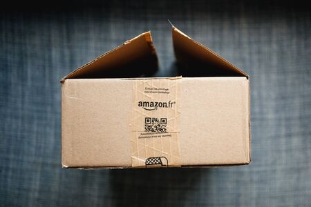 Paris, France - Jan 29, 2019: View from above at the open Amazon Prime cardboard box with Amazon.fr sticker