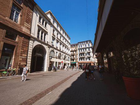 Strasbourg, France - Jun 16, 2018: Rue des Grandes Arcades street with shops, pedestrians on a warm summer day Redakční