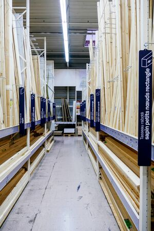 Paris, France - Feb 4, 2019: DIY store with multiple selection of wooden bars for construction and home renovation