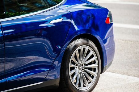 Strasbourg, France - May 19, 2016: Rear part of modern luxury Tesla Model S 90D electric supercar in beautiful blue color parked on the French street
