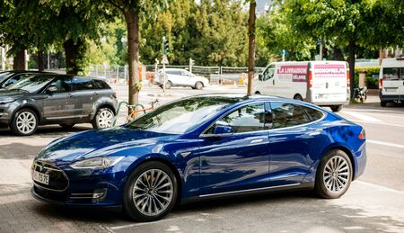 Strasbourg, France - May 19, 2016: Side view of modern elegant luxury Tesla Model S 90D electric supercar in beautiful blue color parked on the French street Redakční