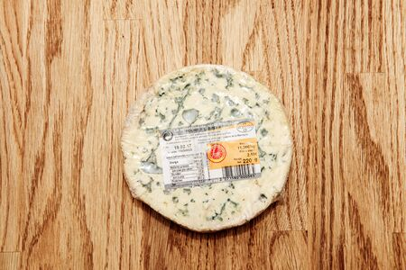 Paris, France - Feb 4, 2017: View from above at the fresh and tasty French Fourme dAmbert cheese with descritpion of ingredients Redakční