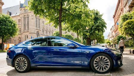 Strasbourg, France - May 19, 2016: Presentation of new modern luxury Tesla Model S 90D electric supercar in beautiful blue color parked on the French street