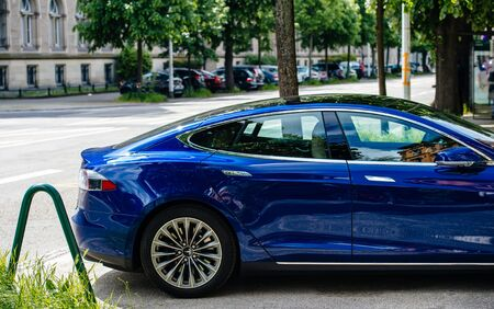 Strasbourg, France - May 19, 2016: Side view of new modern luxury Tesla Model S 90D electric supercar in beautiful blue color parked on the French street Redakční