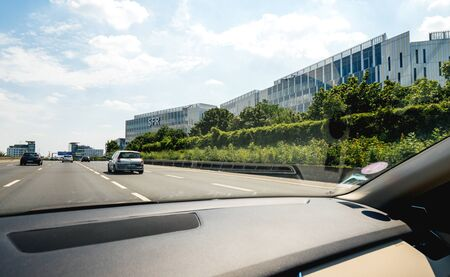 Paris, France - Jul 15, 2019: View from the car at wide office buildings headquarters with SFR icon on the facade French telecommunications company that provides voice, video, data, and Internet telecommunications Redakční
