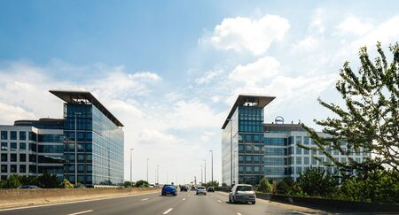 Paris, France - Jul 15, 2019: Office buildings headquarters with Dell Computers icon on the top of the building on Avenue du Stade de France - view from the car driving on Avenue Peripheriques Redakční