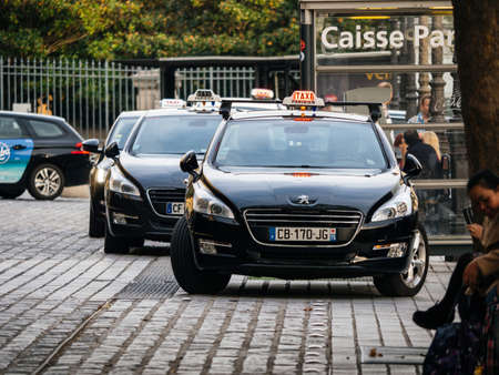Paris, France - Oct 13, 2018: French Peugeot Taxi cars in a row at the Gare de Est waiting for customers - public transportation