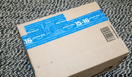 PARIS, FRANCE - JUL 4 2109: View from above of new Amazon Prime Day cardboard parcel with special blue tape for the Prime Day