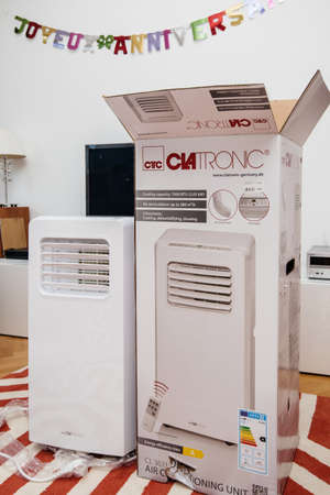 Paris, France - Jun 23, 2019: New new portable air conditioner unit AC during hot summer manufactured by Clatronic near his box after unpacking Editorial