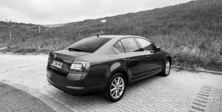 Overveen, Netherlands - Aug 16, 2018: Rear view of new Skoda Octavia Parked on a beach park space in Netherlands on a cloudy day black and white image Editorial