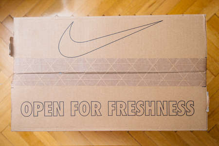 Paris France - Jul 7 2019: Above view unboxing unpacking sport running shoes equipment manufactured by Nike sportswear - open for freshness and icon of the brand