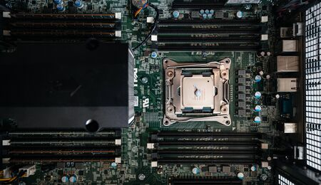 Paris, France - May 31, 2019: CPU thermal paste grease applied on a second Intel Xeon 2687w V4 CPU processor in Dell Precision professional workstation