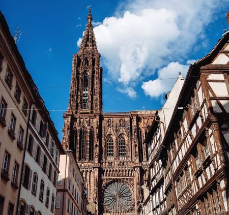 Square image of Iconic Strasbourg Cathedral or the Cathedral of Our Lady of Strasbourg, also known as Strasbourg Minster the Catholic cathedral blue sky in the background