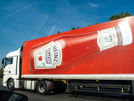 Amsterdam, Netherlands - Aug 22, 2019: Side view of large cargo truck with Heinz Tomato Ketchup bottle advertising the famous food product