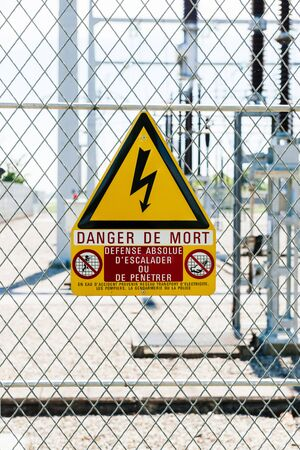 Danger de Mort sign translated as danger of death at the security fence entrance at hydroelectric power plant at Centrale Hydroelectrique de Gambsheim