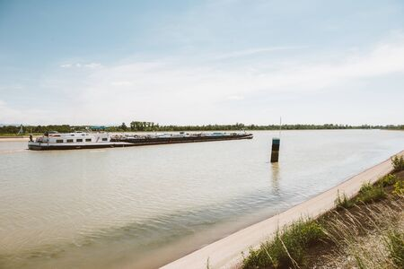 Wide image of large barge cargo boat on the Rhine River transporting goods Banco de Imagens