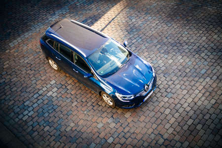 Hamburg, Germany - Mar 2018: View from above overhead view of blue new Renault Wagon car parked on the cobblestone parking 報道画像