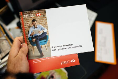 Paris, France - Dec 1, 2019: man hand holding open letter from HSBC Hong Kong Shanghai Banking Corporation bank with 4 special offer for the retreat