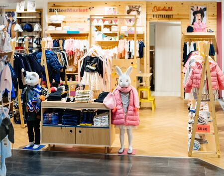 Barcelona, Spain - Nov 17, 2017: Two rabbit and cat mannequins silhouettes wearing luxury jackets in upscale fashion clothes store Calvin Klein in El Corte Ingles 報道画像