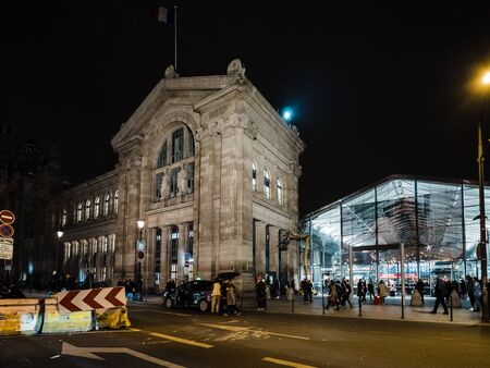 Paris, France - Jan 20, 2019: iconic building of Gare de Nord in central Paris with commuters people walking in winter old and modern glass pavilion