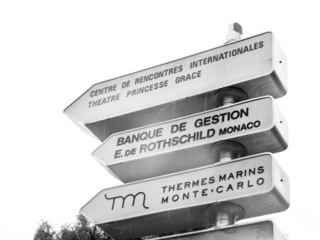 Monaco - Nov 23, 2019: Black and white image of multiple arrows in central Monaco to Princess Grace theater, Rothschild bank and Thermes Marins Monte Carlo Archivio Fotografico - 139239559