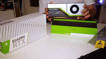 Paris, France - Mar 11, 2019: Curious man showing the new Nvidia Quadro RTX 5000 for workstations running professional CAD, CGI, DCC application software video card GPU
