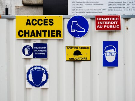 Paris, France - Jan 1, 2018: Multiple safety regulation signs on the construction site protection of head, eyes, ears and red forbidden for public sign 新聞圖片