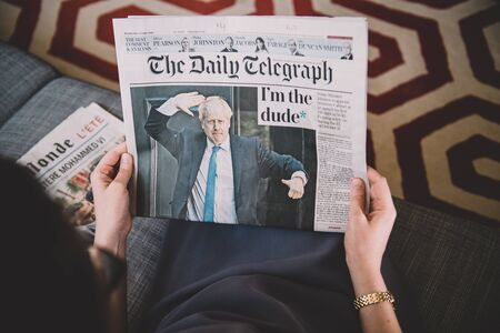 Paris, France - Jul 24, 2019: reading newspaper with Boris Johnson appears on cover of the Daily Telegraph as he becomes UK United Kingdom Prime Minister - im the dude title 에디토리얼