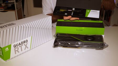 Paris, France - Mar 11, 2019: Curious man unboxing unpacking new Nvidia Quadro RTX 5000 for workstations running professional CAD, CGI, DCC application software video card GPU showing accesories cable 에디토리얼