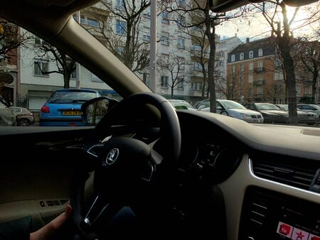 Strasbourg, France - Nov 21 2018: View from inside the ar of woman hands holding steering wheel of a Skoda car