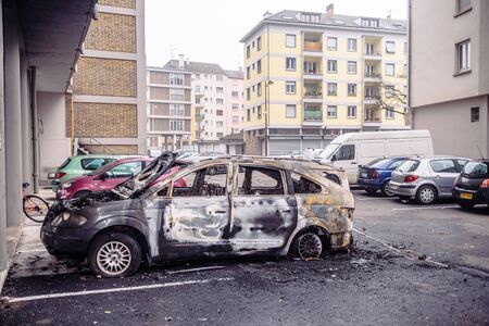 Strasbourg, France - Jan 1, 2020: Side view of burnt car as Vandals marked the start of 2020 by setting countless vehicles on fire in front of HLM poor neighborhood