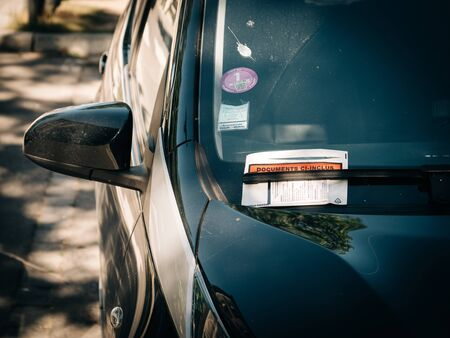 Strasbourg, France - Sep 21, 2019: Documents inclus translated as included documents - plastic pouch with parking fine ticket