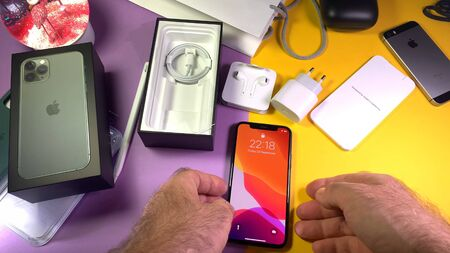 Paris, France - Sep 20, 2019: POV man hand after unboxing unpacking highly acclaimed new Apple Computers iPhone 11 Pro and 11 Pro Max smartphone triple-lens camera