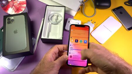 Paris, France - Sep 20, 2019: Apps shortcuts POV man hand unboxing unpacking highly acclaimed new Apple Computers iPhone 11 Pro and 11 Pro Max smartphone triple-lens camera
