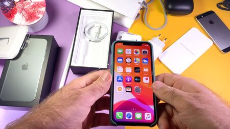 Paris, France - Sep 20, 2019: Holding with two hands POV man hand unboxing unpacking highly acclaimed new Apple Computers iPhone 11 Pro and 11 Pro Max smartphone triple-lens camera 에디토리얼